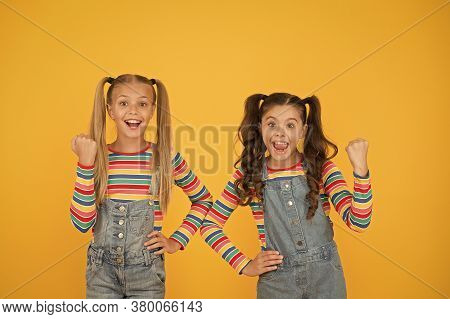 Happy School Children Friendship. Best Friends Forever. Small Sisters Have Fun. Little Girls Yellow