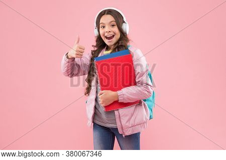 Perfect Learning. Happy Child Give Thumbs Up Pink Background. Approval Gesture. Hand Sign. Little Gi