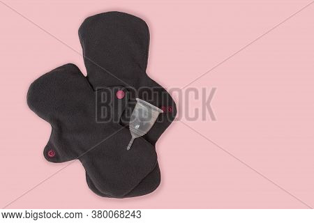 Female Personal Hygiene Products Isolated Menstrual Cup And Reusable Pads On A Pink Background As A
