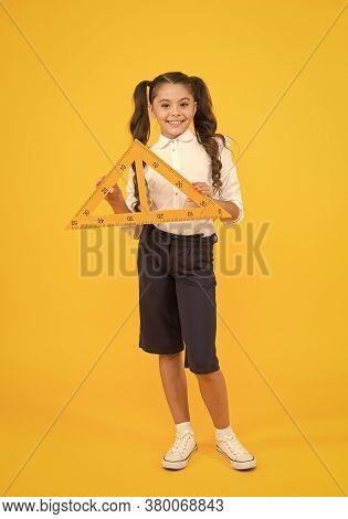 Schoolgirl School Uniform Hold Big Ruler Geometry School Lesson. Math Stem Architecture Faculty. Mea