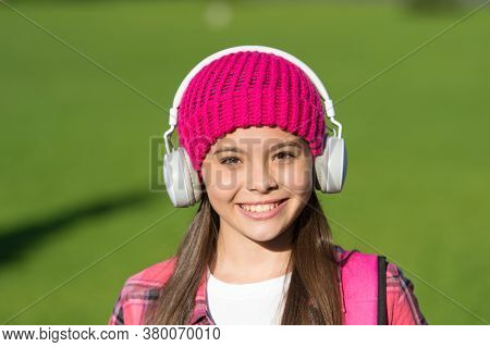 Music Makes You Smarter. Happy Girl Listen To Music Sunny Outdoors. Little Kid Wear Headphones Playi