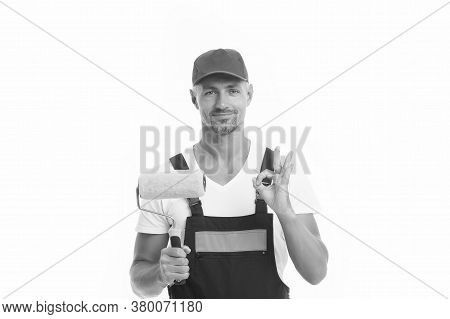 Able To Work Quickly And Accurately. Painter Decorator Show Ok Sign Isolated On White. Work Man Hold