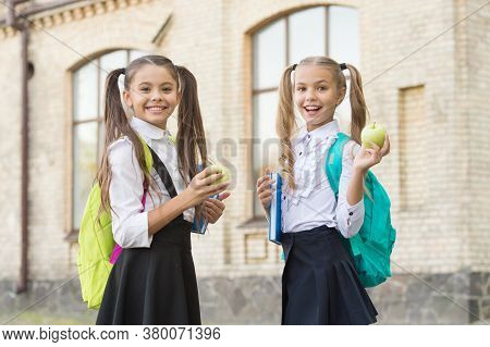 Students Girls Classmates With Backpacks Having School Lunch, Breakfast Food Concept.