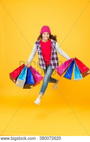 Place Where You Buy Emotions. Energetic Shopping Addict Yellow Background. Happy Child Carry Shoppin