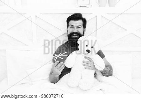 Man Hug Soft Toy Relaxing In Bed. Make Surprise Concept. Gift For Spouse. Cute And Romantic Gift. Be