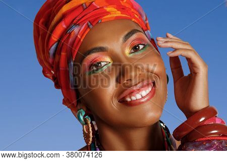 Portrait Of A Young And Attractive African American Black Woman Smiling In The National African Dres