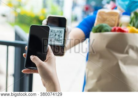 Customer Hand Using Digital Mobile Phone Scan Qr Code Paying For Buying Fresh Food Set Bag From Food