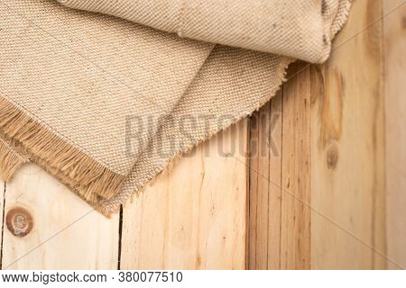 Sackcloth On A Wooden Background