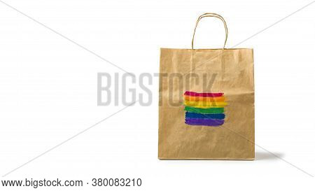 Lgbt Rainbow Flag Painted On A Paper Gift Bag. Concept Of Lgbt And Human Rights. Black Friday, Seaso