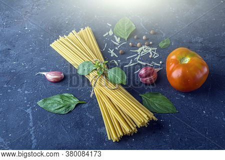 Fresh Ingredients For Cocking Pasta With Traditiona Italian Sauce Pesto. Dry Spaghetti, Basil Leaves