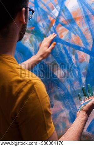 Impressionism Painter In Art Studio Painting With Fingers On Large Canvas. Modern Artwork Paint On C