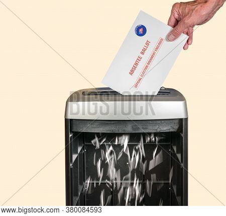 Absentee Ballot Voteing By Mail Envelope Being Shredded In Office Paper Shredder As Concept For Voti