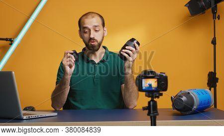 Photographer Testing Camera Lenses While Recording Vlog Episode. Camera Lens Technology Digital Reco