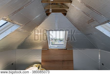 Unfinished Residential Loft Conversion With Silver Insulation