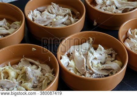 Boiled Chicken Proportionally Laid Out In Clay Bowls.