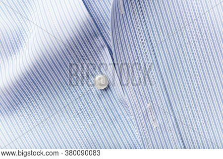 Close Up Of Men's Striped Shirt. Top View. Copy Space.