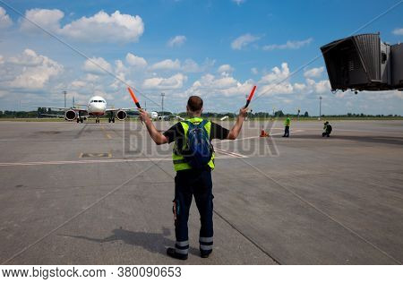 Kyiv, Ukraine - June 23, 2020: Airplane Traffic Controller At Work. The Plane Lands At The Internati