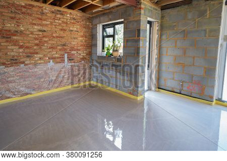 Screeding Over Underfloor Heating Pipes In Residential Property