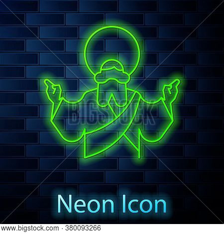 Glowing Neon Line Jesus Christ Icon Isolated On Brick Wall Background. Vector Illustration