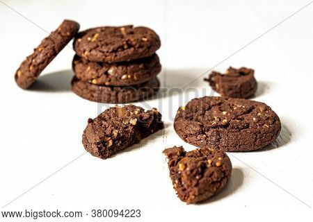 Stuck Of Homemade American Chocolate Cookies With Nuts On White Wooden Background. Fresh Pastry.
