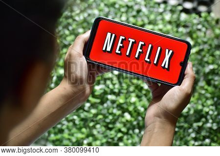 New Delhi, India, September 13 2019: Woman Hand Holding Smart Phone With Netflix Logo Netflix Is A G