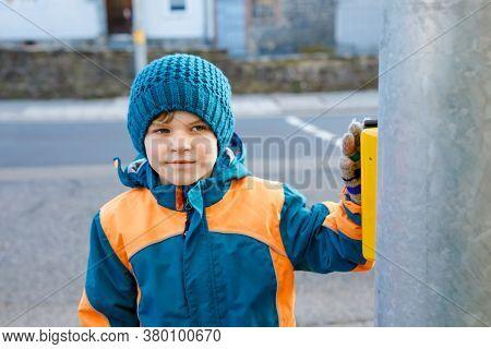 Little School Kid Boy Of Elementary Class Walking To School On Cold Winter Day. Happy Child In Warm