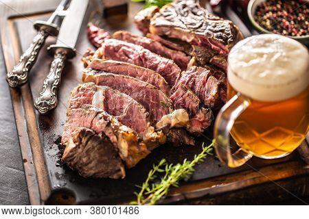 Slices Of Juicy Beef Steak Fork Knife Spices Salt Pepper Herbs And Draft Beer