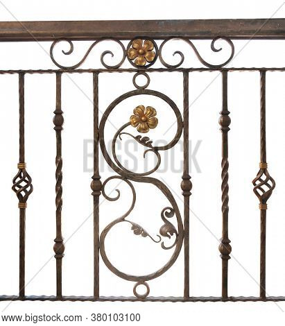 Detail of vintage wrought iron fence. Decorative forged banisters. Fence in retro style. Isolated on white background