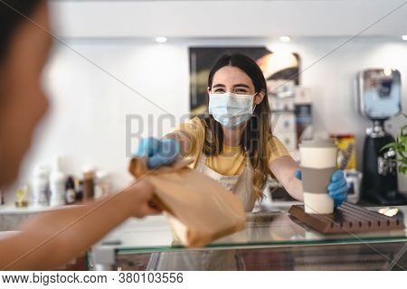 Bar Owner Working Only With Take Away Orders During Corona Virus Outbreak - Young Woman Worker Weari
