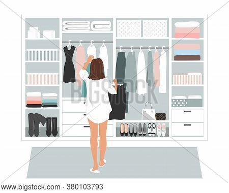 Wardrobe Storage Room And Young Elegant Woman In Front Of Open Closet Full Of Elegant Dresses. Every