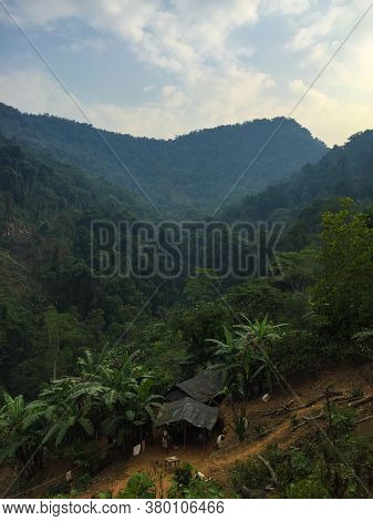 Mountains Full Of Vegetation, Trees, And Little Indigenous Houses In The Ciudad Perdida (lost City)