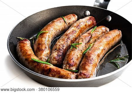 Delicious  Pork Chipolatas Sausages In A Frying Pan Isolated On White