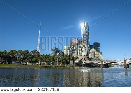 Melbourne skyline with skyscrapers and famous  Melbourne Arts Centre Spire seen across the river Yarra. Victoria, Australia