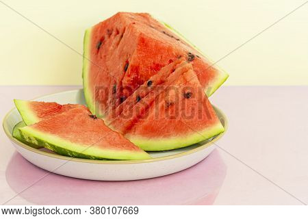 Delicious Red Sliced Watermelon On A Plate. Stock Of Fiber And Fructose. Summer Food Concept.