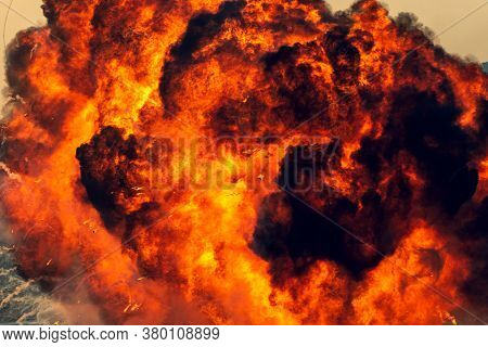 Massive Black And Orange Fire Explosion In Military Combat And War. Vehicle Explosure From A Tank In