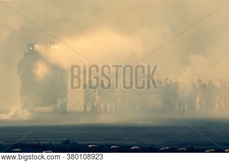 Military Police Riot Response To A Protest With Tear Gas, Smoke, Fire, Explosions. Political Express