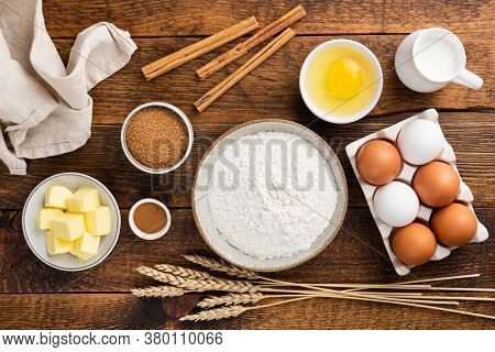 Baking Ingredients On A Wooden Table Background. Ingredients For Baking A Cake, Cookies Or Pastry. T