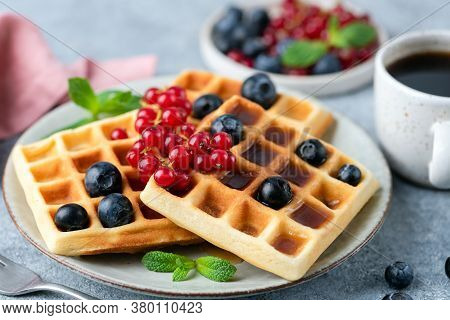 Belgian Waffles With Berries, Square Shape. Sweet Dessert Waffles Served With Cup Of Black Coffee