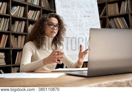 Female Young Hispanic School Math Teacher, College Tutor Coach Looking At Webcam And Talking In Clas