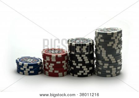 Poker Chips Piled On A White Background
