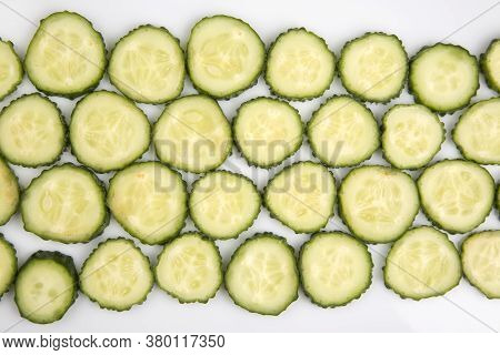 Sliced pieces Of Cucumber On A White Background. Fast Food And Breakfast