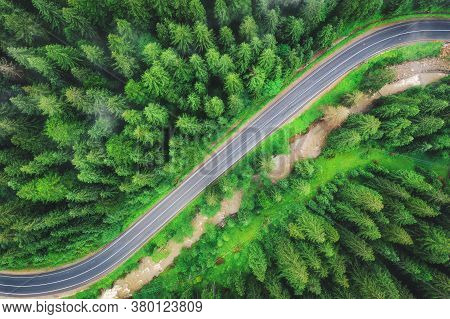 Aerial View Of Road In Beautiful Green Forest At Sunset In Summer. Colorful Landscape With Roadway,