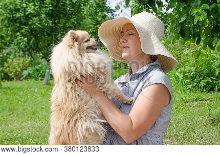 Beautiful Stylish Elderly Woman, Senior Lady In Hat, Holding Dog In Her Arms, Adult Female Hugging G