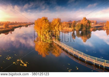 Old Fisherman House And Wooden Pier At Sunrise In Autumn. Aerial View. Panoramic Landscape With Hous