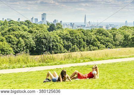 June 2020. London. People Relaxing On Hampstead Heath, London, England Uk Europe