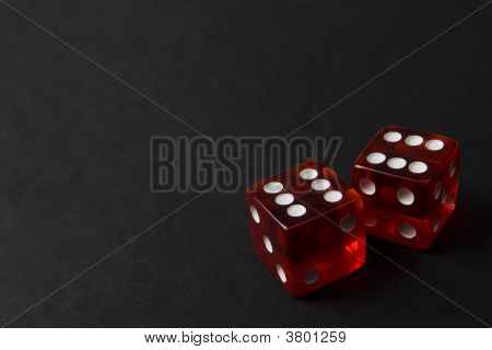 Two Red Dice On A Dark Background