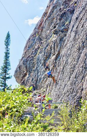 Canmore, Canada - July 28, 2020: Rock Climbers Scale The Steep, Pocketed Crags At Grassi Lakes In Ca