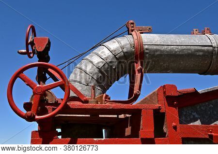 The Gears And Wheels For Moving The Blower Of An Old Threshing Machine Have Been Reconditioned And P