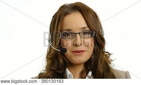 Businesswoman talking on the headset.