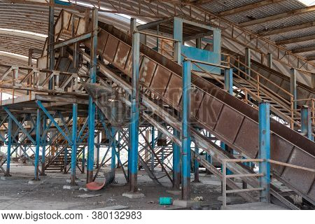 Old Abandoned Recycling Plant. Trash Deposit. Modern Pollution Concept.